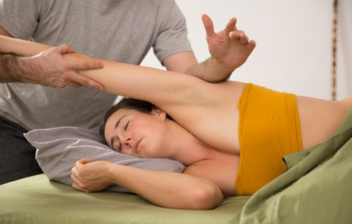 Rolfer rolfing shoulder sidelying in Los Angeles